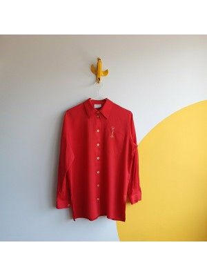 Red shirt with golden buttons