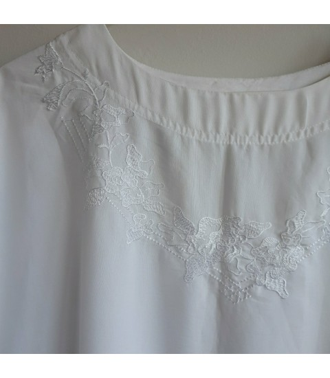 Romantic blouse with embroidered neckline